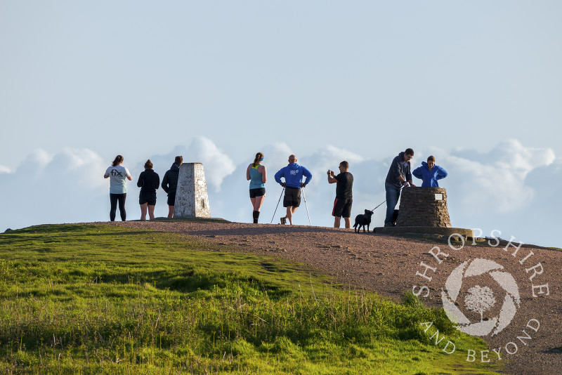 Walkers on the summit of the Wrekin in Shropshire.