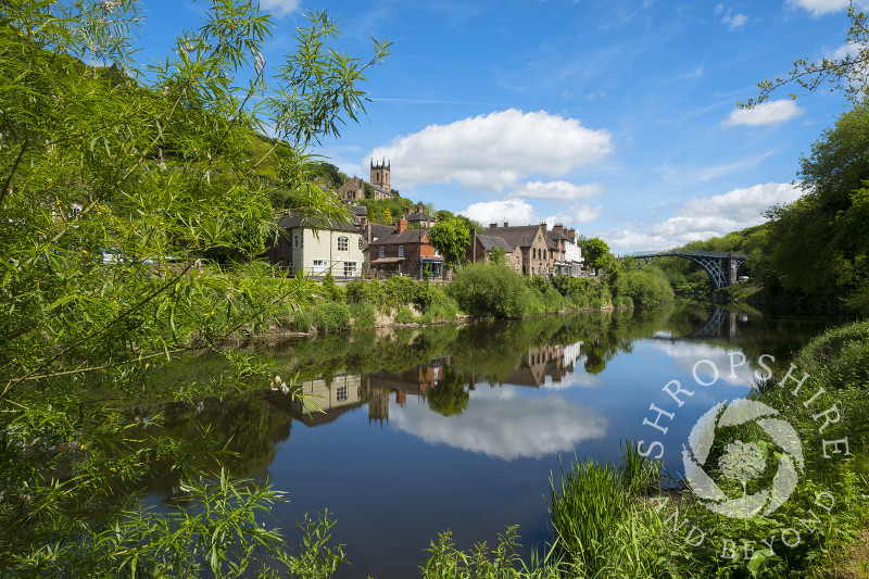 The town of Ironbridge reflected in the River Severn, Shropshire.