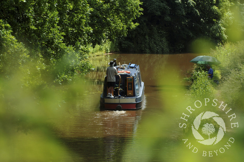 A canal boat on the Shropshire Union Canal at Tyrley Locks, near Market Drayton, Shropshire, England.