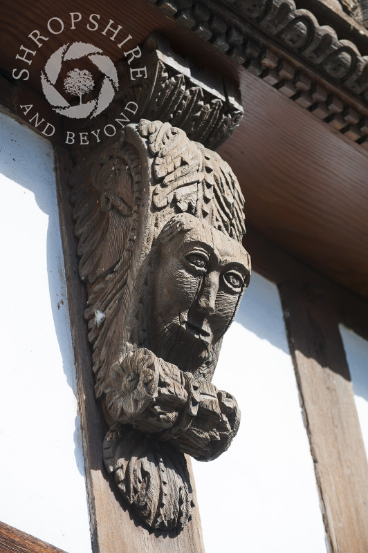 Carved wooden corbel on a building in Broad Street, Ludlow, Shropshire, England.