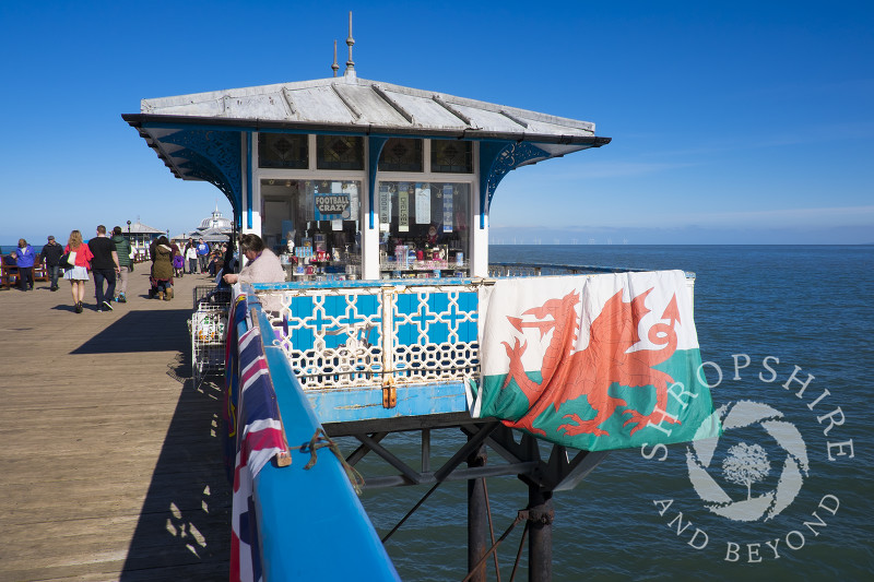 A Welsh flag displayed outside a kiosk on Llandudno Pier, North Wales.