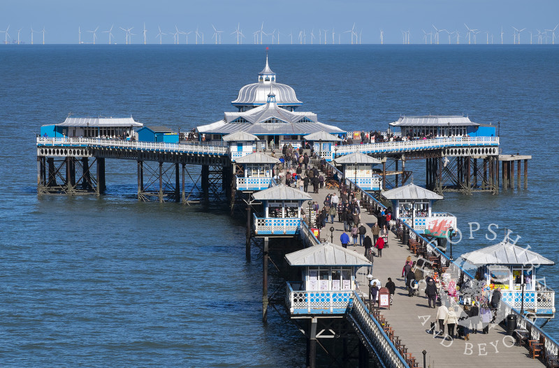 A busy day on Llandudno Pier, North Wales, looking towards the  offshore wind farm.