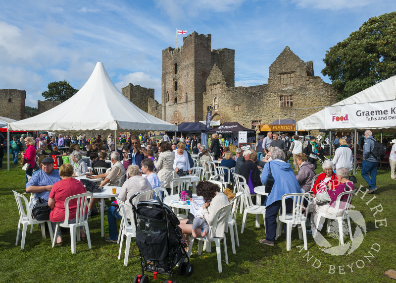 Visitors to the 2016 Ludlow Food Festival enjoy the sunshine in the grounds of Ludlow Castle, Shropshire.