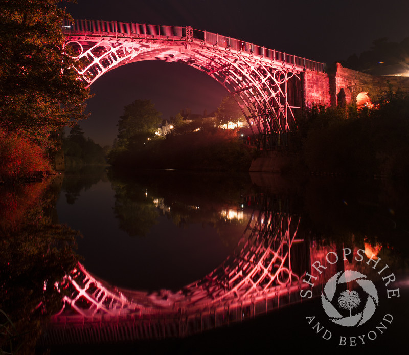 The Iron Bridge reflected in the River Severn at Ironbridge, Shropshire, England.
