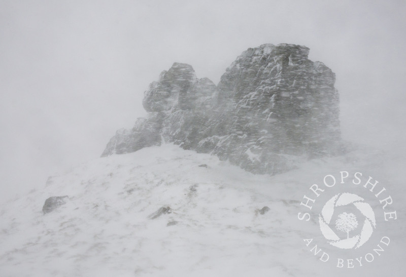 Three Fingers Rock during a blizzard on Caer Caradoc, Shropshire.