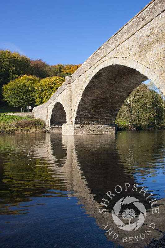 Dinham Bridge reflected in the River Teme in autumn, Ludlow, Shropshire, England.
