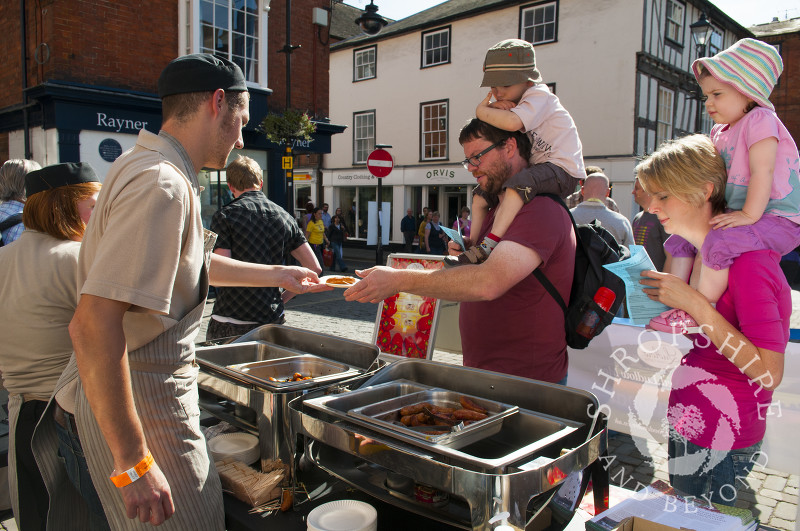 A family takes part in the Sausage Trail at Ludlow Food Festival, Shropshire, England.