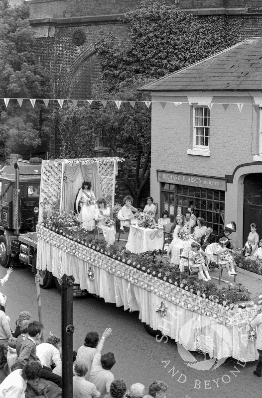 The Carnival Queen's float in Victoria Road, Shifnal, Shropshire, during the annual parade in June 1987.