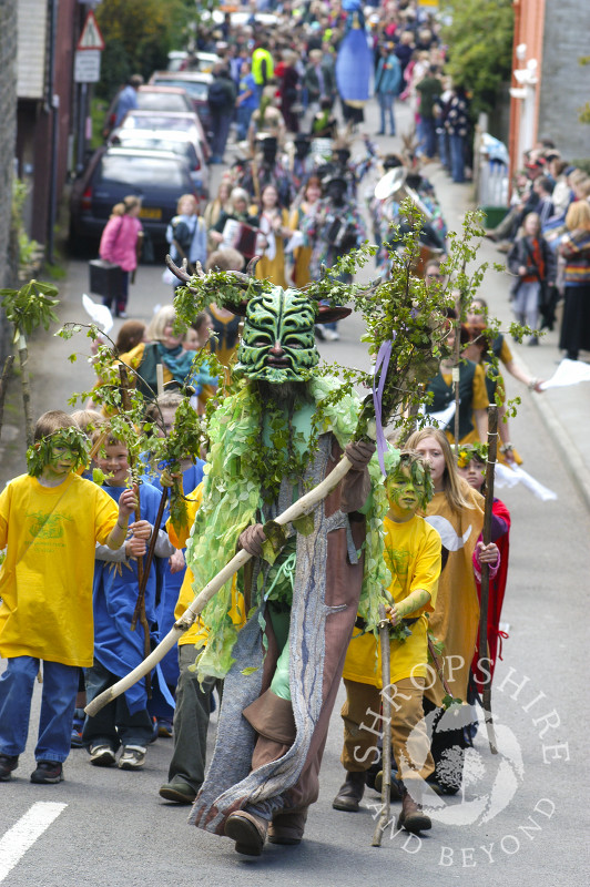 The Green Man heads a procession at the Clun Green Man Festival, Shropshire.