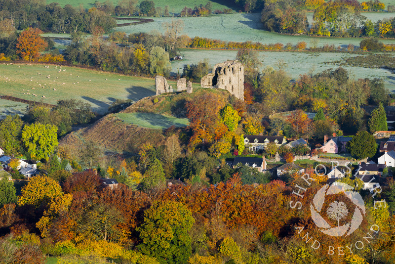 A frosty autumn sunrise highlights the town and castle ruins at Clun, Shropshire.
