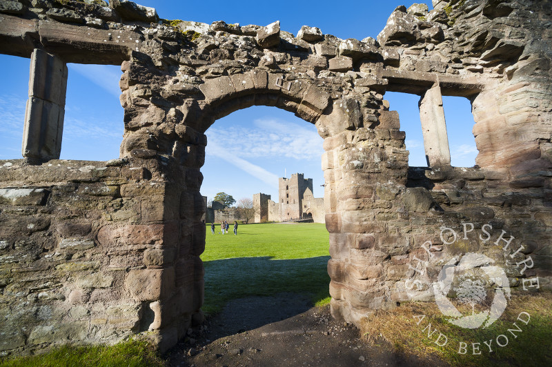 A view of the Outer Bailey at Ludlow Castle seen through a ruined doorway, Ludlow, Shropshire, England.