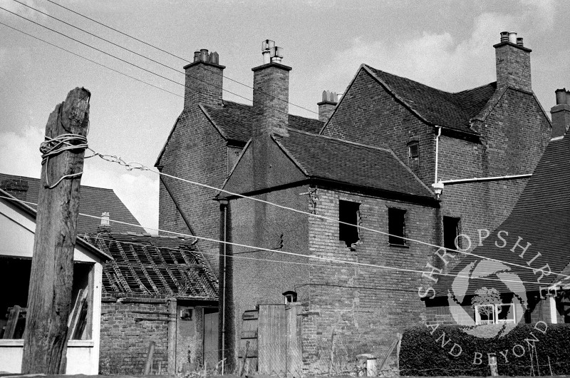 A house adjacent to the Wheatsheaf public house awaits demolition in Broadway, Shifnal, Shropshire, in 1966.
