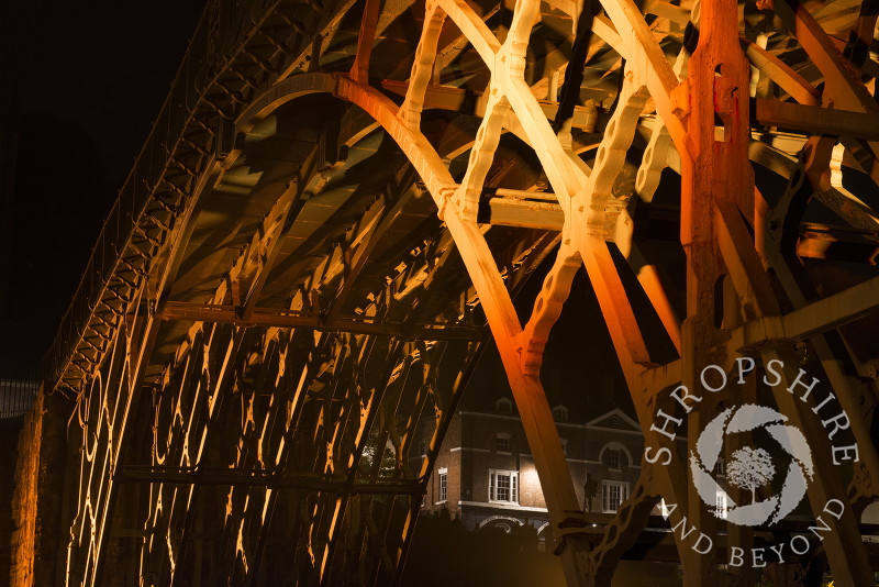 The Iron Bridge at Ironbridge, Shropshire, England. It was illuminated as part of the Night of Heritage Light, celebrating UNESCO world heritage sites.