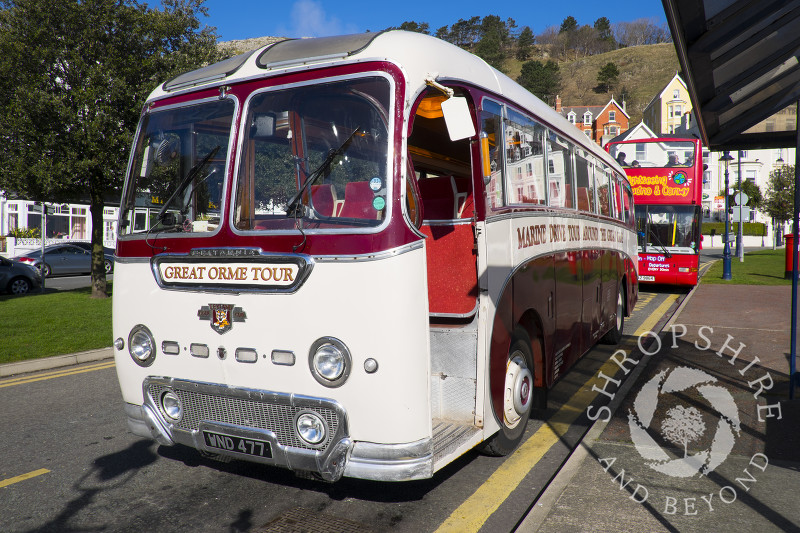A tour bus on the seafront at Llandudno, North Wales.