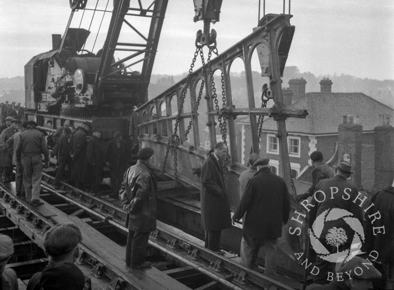 A section of the old railway bridge being lifted away, Shifnal, Shropshire, 1953.