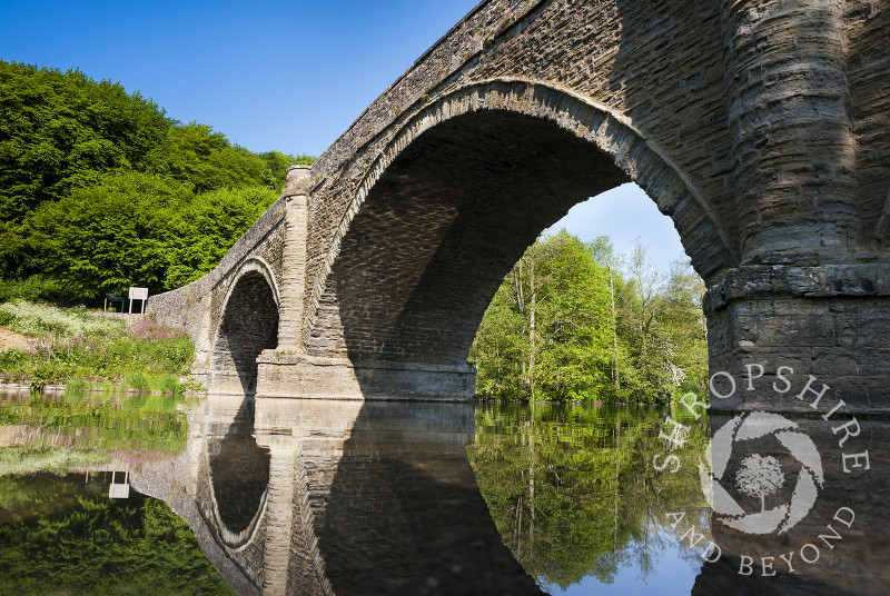 Dinham Bridge reflected in the River Teme at Ludlow, Shropshire, England.