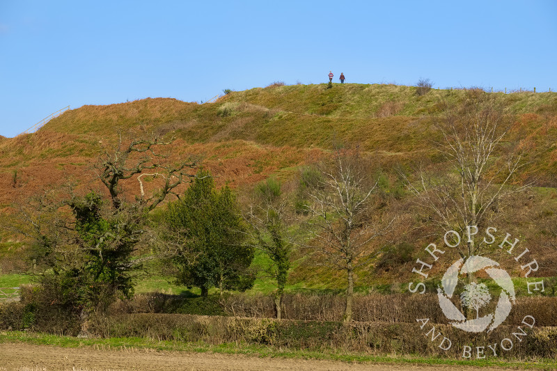 Walkers on the ramparts of Old Oswestry Hill Fort, north Shropshire.