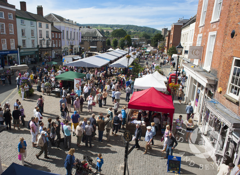 Visitors throng the stalls in Castle Square during the Ludlow Food Festival, Shropshire, England.