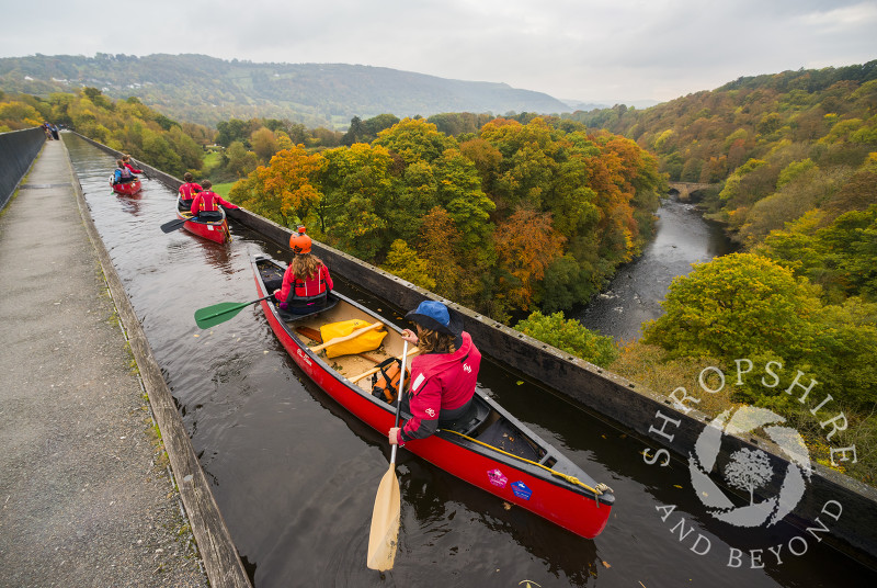 Canoeists on the Llangollen Canal above the River Dee on the Pontcysyllte Aqueduct, near, Wrexham, Wales.