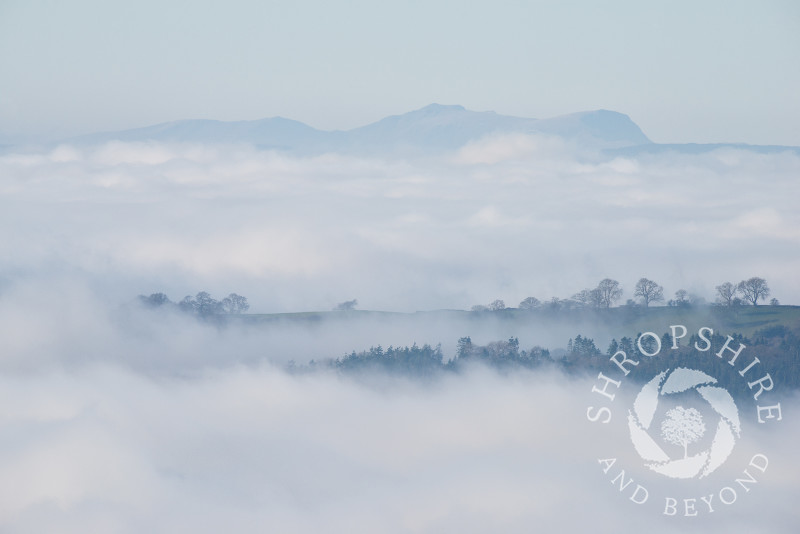 Mist over south Shropshire, seen from Bromlow Callow, with the Breidden Hills, Powys, in the distance.