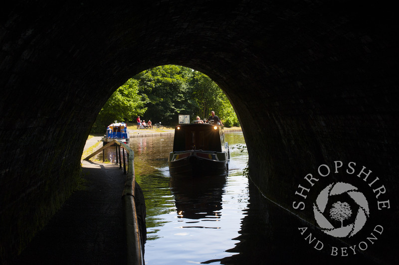 A canal boat enters Darkie Tunnel at Chirk, Wrexham, Wales.