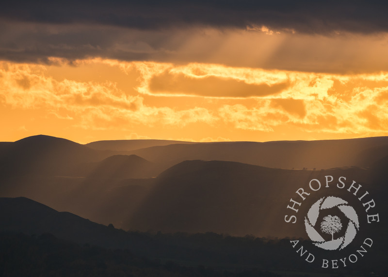 Dramatic evening light on the Long Mynd, seen from the Wrekin, Shropshire.
