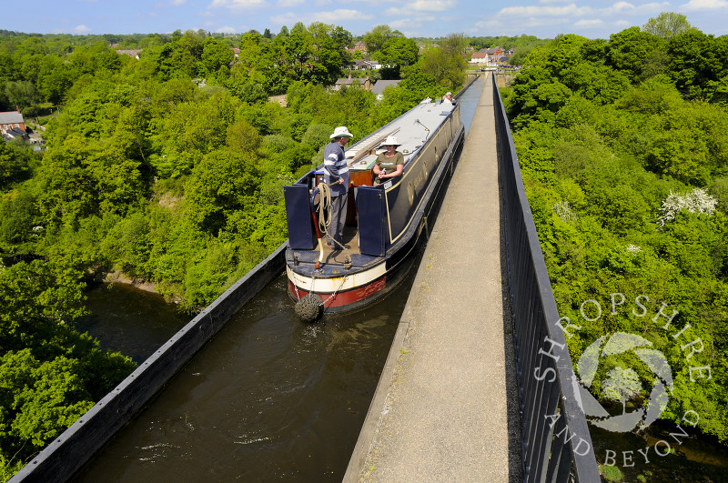 A narrowboat passes along the Llangollen Canal on the Pontcysyllte Aqueduct, North East Wales.