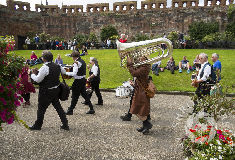 A marching band of Morris dance musicians in Shrewsbury Castle during Shrewsbury Folk Festival, Shropshire, England.