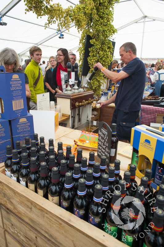 A vendor pulls a pint of beer at Ludlow Food Festival, Shropshire, England.
