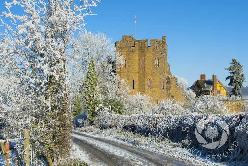 A frosty lane near the South Tower and Gatehouse of Stokesay Castle, Shropshire, England.
