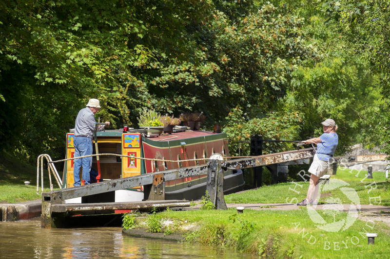 A narrowboat negotiates Adderley Locks on the Shropshire Union Canal, Shropshire.