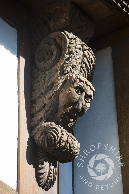 Wooden carved corbel on a building in Broad Street, Ludlow, Shropshire, England.