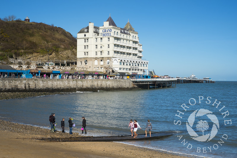 The Grand Hotel overlooks the pier and seafront at Llandudno, north Wales.