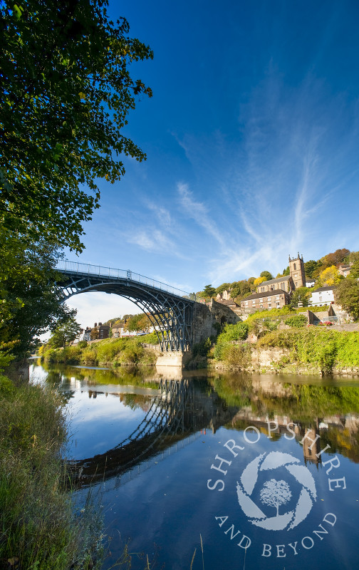 The Iron Bridge at Ironbridge, reflected in the River Severn, Shropshire, England.