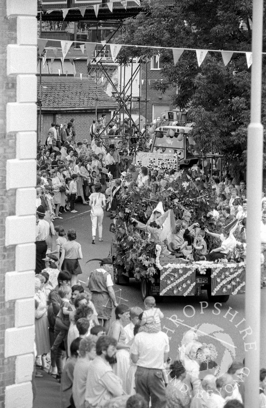 The carnival procession makes its way into Market Place, Shifnal, Shropshire, in June 1987.