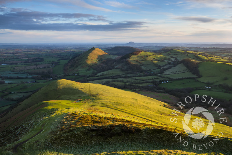 Winter sunrise on Caer Caradoc and the Lawley, Stretton Hills, Shropshire. The Wrekin can be seen in the far distance.
