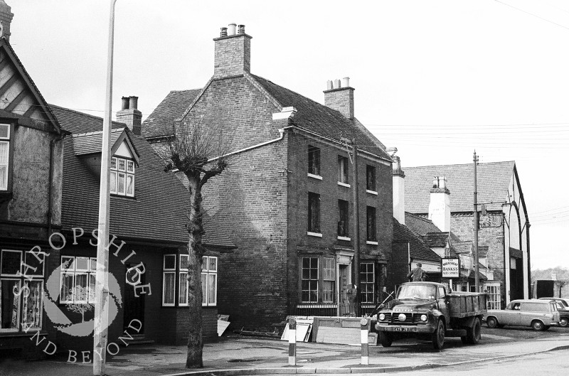 A house in the process of being demolished next to the Wheatsheaf public house in Broadway, Shifnal, Shropshire, in 1966.