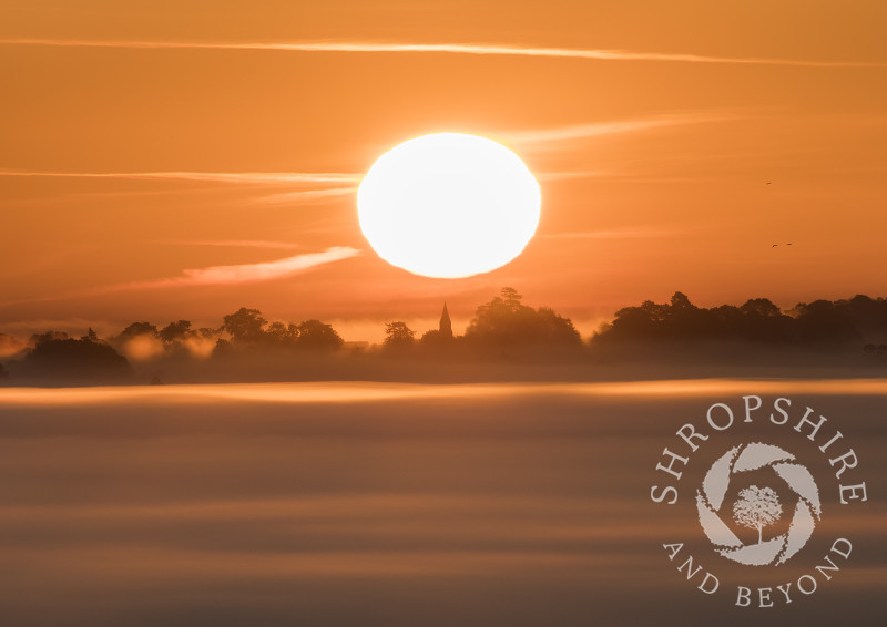 Sunrise over St Andrew's Church at Welsh Frankton, seen from Old Oswestry Hill Fort, Shropshire.