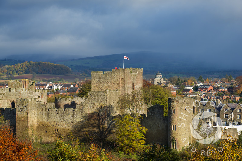 Ludlow castle in autumn, with an approaching shower over Brown Clee Hill, Shropshire, England.