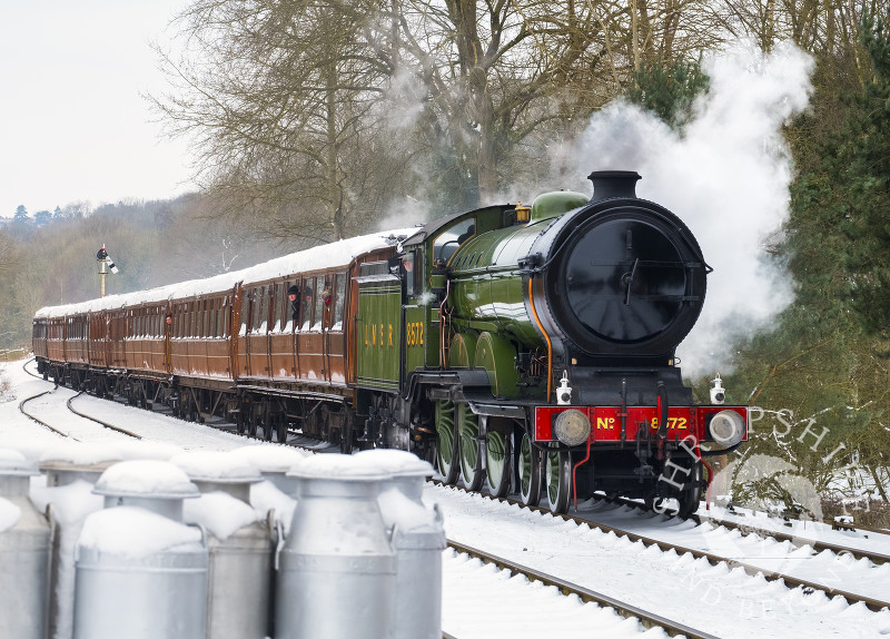LNER steam locomotive 8572 pulling into Hampton Loade station on the Severn Valley Railway, Shropshire.