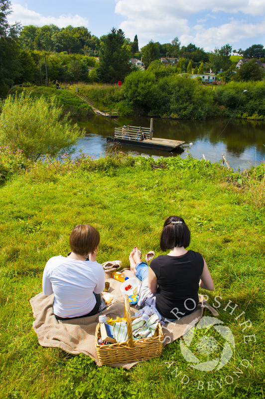 Picnic time overlooking Hampton Loade ferry across the River Severn, near Bridgnorth, Shropshire, England.