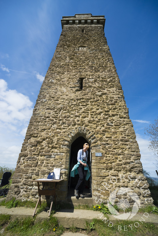 A visitor exits Flounders' Folly on Callow Hill near Craven Arms, Shropshire, England.