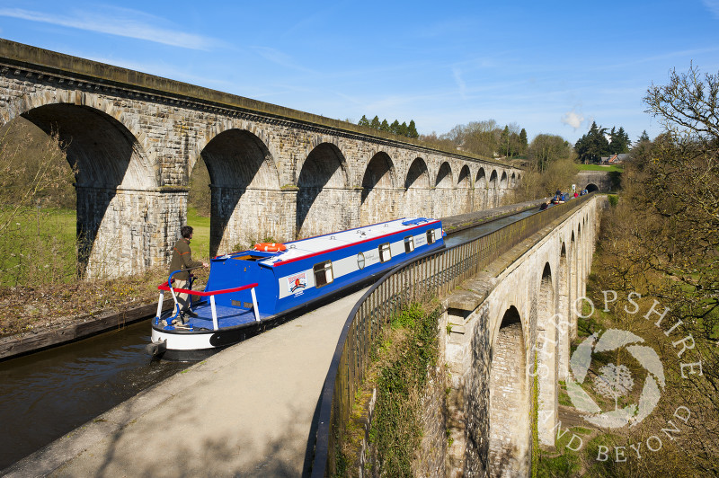 A canal boat crossing Chirk Aqueduct on the Llangollen Canal, on the English/Welsh border.