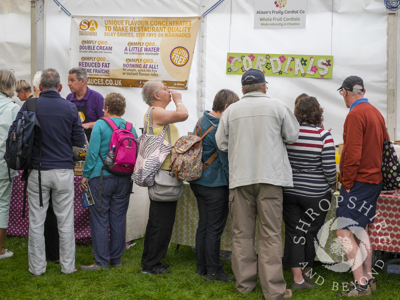 Visitors sample sauces and cordials at Ludlow Food Festival, Shropshire.