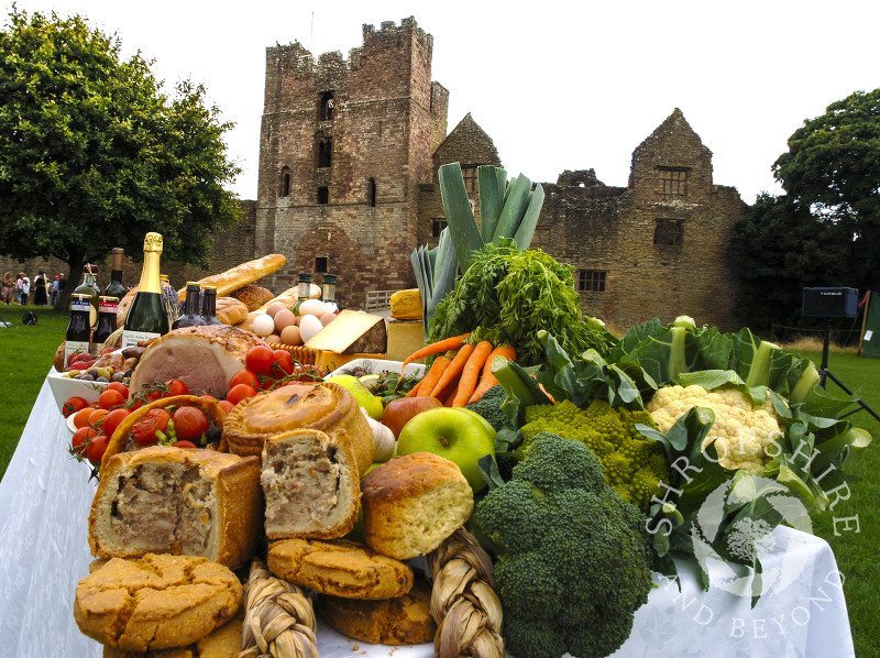 A table of produce on display in the grounds of Ludlow Castle during Ludlow Food Festival, Shropshire.