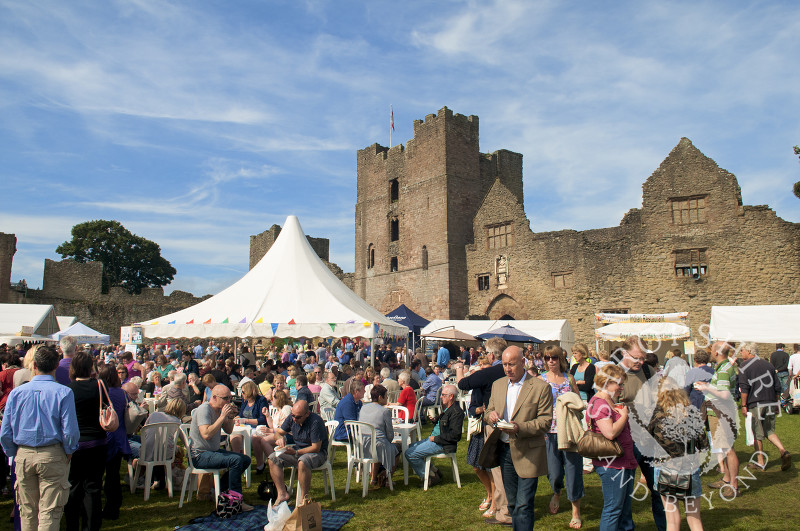 Visitors throng the castle grounds during the Ludlow Food Festival, Shropshire, England.