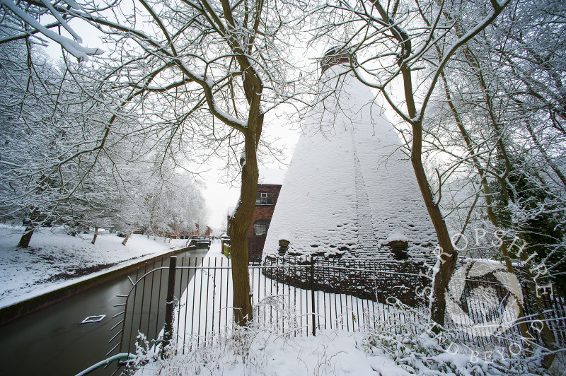 Snow-covered bottle kiln at the Coalport China Museum, one of the Ironbridge Gorge Museums, at Coalport, Shropshire.