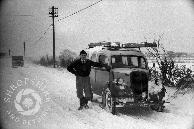 Electrician Ron Browne with Fordson van in deep snow on the Bridgnorth road out of Shifnal, 1963.