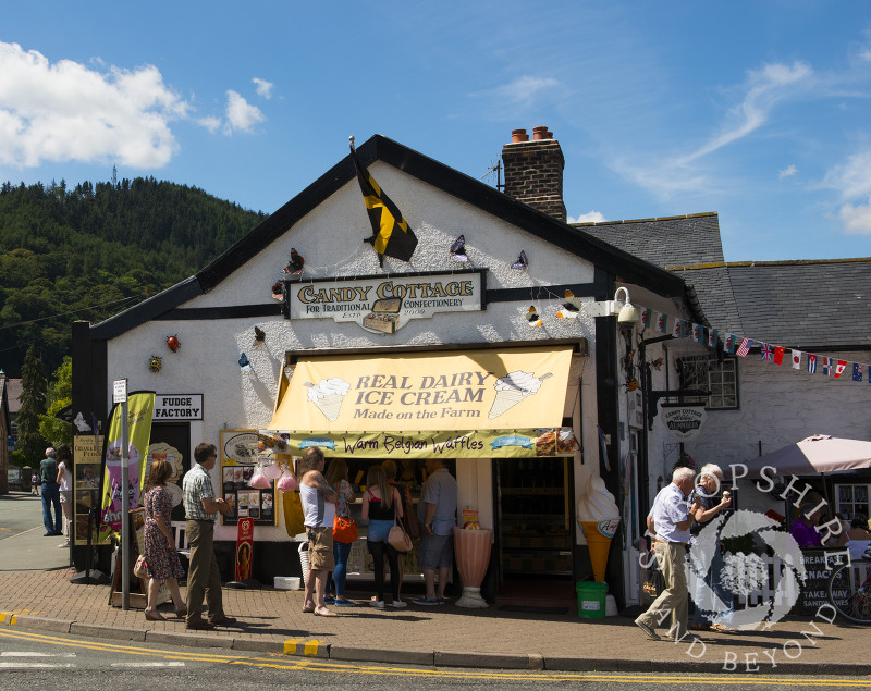 People queue outside an ice cream shop in Llangollen, Denbighshire, Wales.