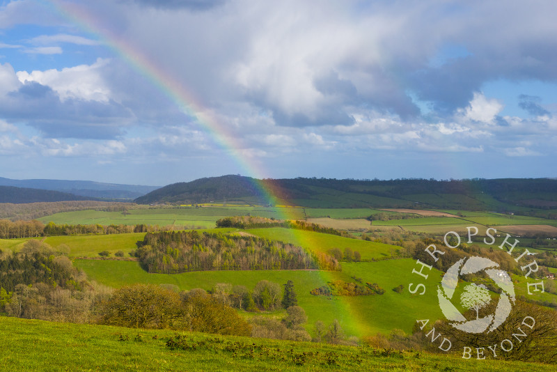 A rainbow over the south Shropshire countryside seen from Burrow Hill, near Craven Arms, Shropshire, England.